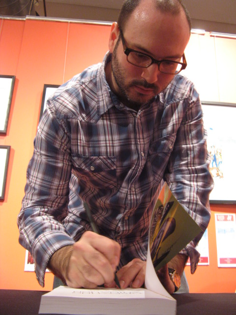 Yours truly, signing a book.